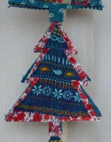 Close up of Christmas tree hanging, made with recycled fabric. Handmade Christmas decoration.