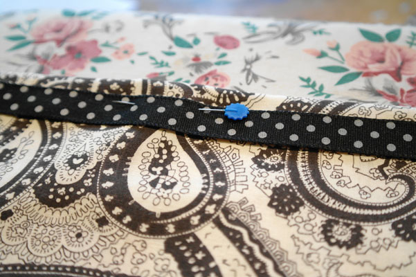 Ribbon pinned to the top edge of a pocket