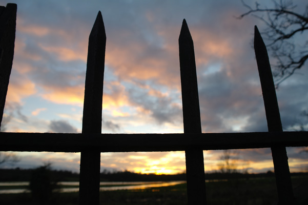 Railings silhouetted against the sunset on Christmas day 2012