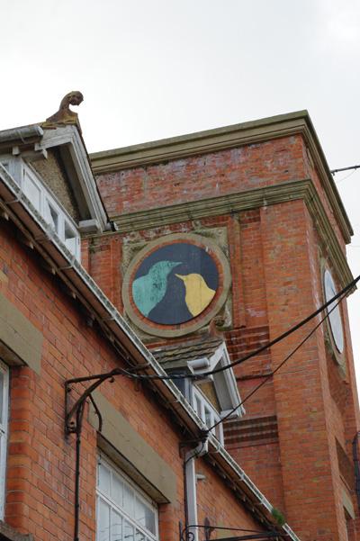 Bird mural on a building, Bridport, Dorset.