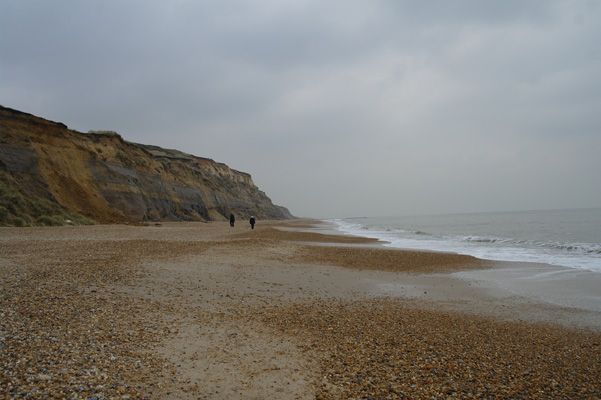 Hengistbury Head, Dorset, England. Walking along the beach in February.