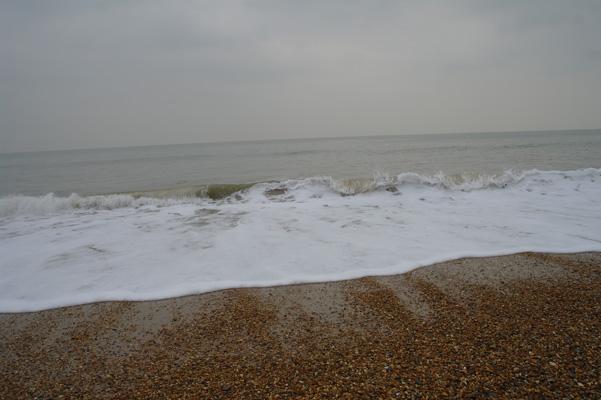 Wave on the beach at Hengistbury Head.