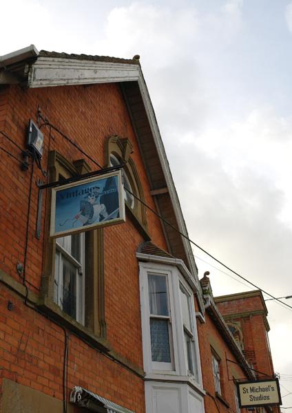 Signs for the vintage shops, in Bridport, Dorset.
