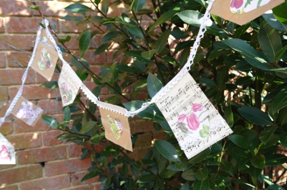 Recycled paper and old sheet music heart bunting.
