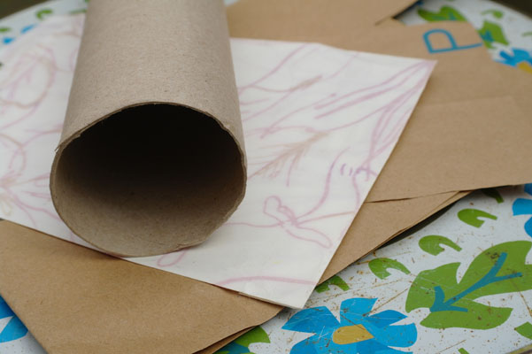 Cardboard tube and scraps of paper