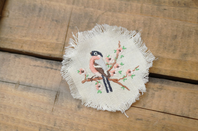 Vintage embroidered bird, in the process of being turned into a brooch.