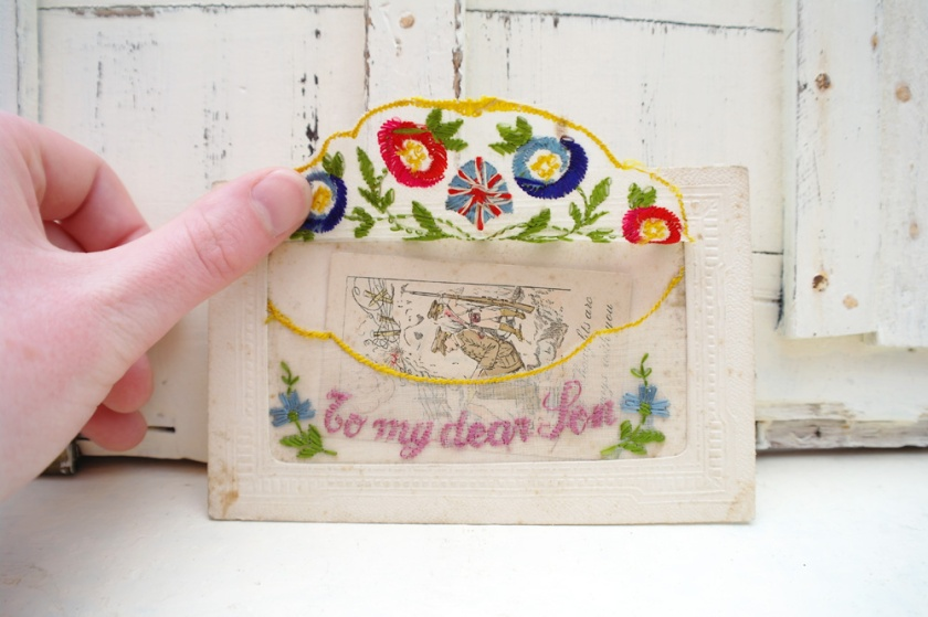 Pocket of an embroidered postcard from the First World War.