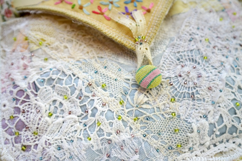 Close-up of beading on bag made with vintage materials.