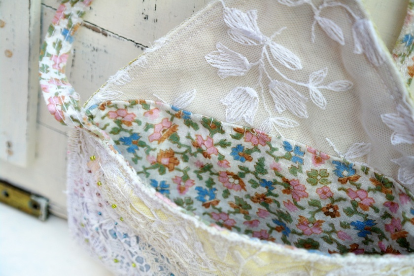 Vintage fabric lining for bag made with vintage lace, embroidery, and fabrics.