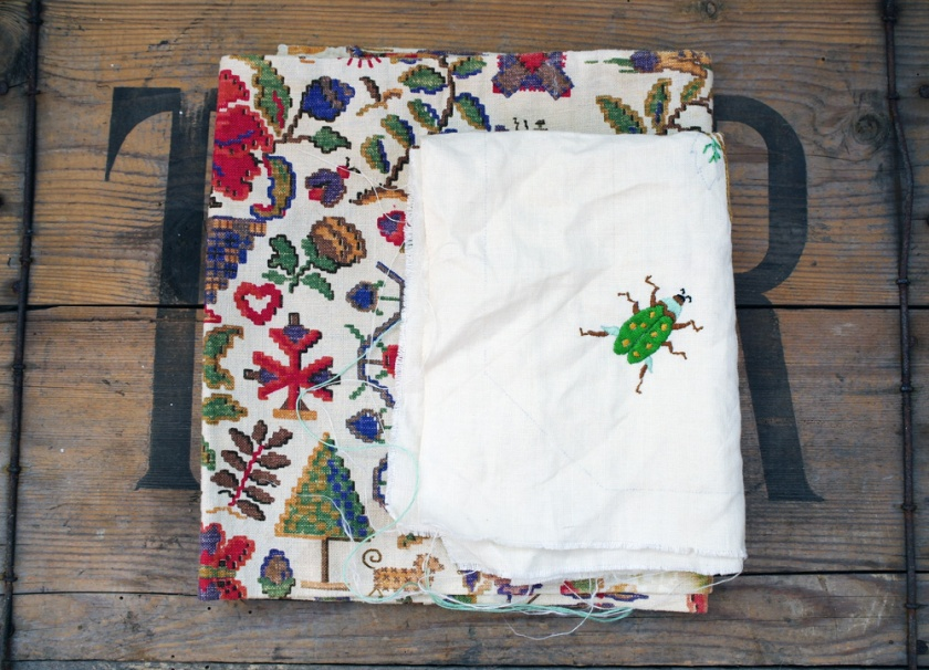 Vintage fabric and embroidery finds. Embroidered beetle.