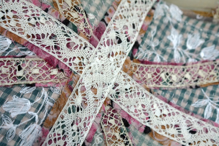 Close up of beaded details on the crosses of the Union Jack textile wall hanging.