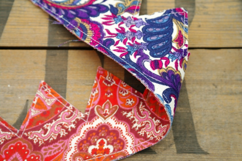 Reversible retro fabric crowns. Upcycled retro fabrics. Purple, orange, pink, paisley print.
