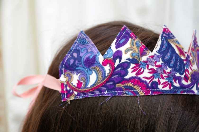 Side of retro fabric crown. Made with upcycled seventies paisley fabric. Vintage fabric. Purple, pink, blue, and white.