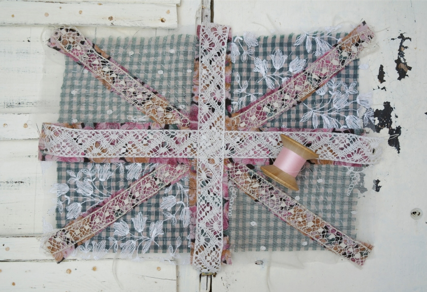 Union Jack wall hanging, work in progress. Made with vintage lace and fabrics. Upcycled recycled repurposed. British flag.