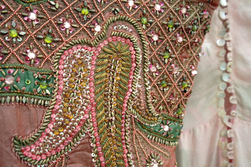 Detail of vintage Indian dress and pink 1930s dress. Indian beading. Pink, green.