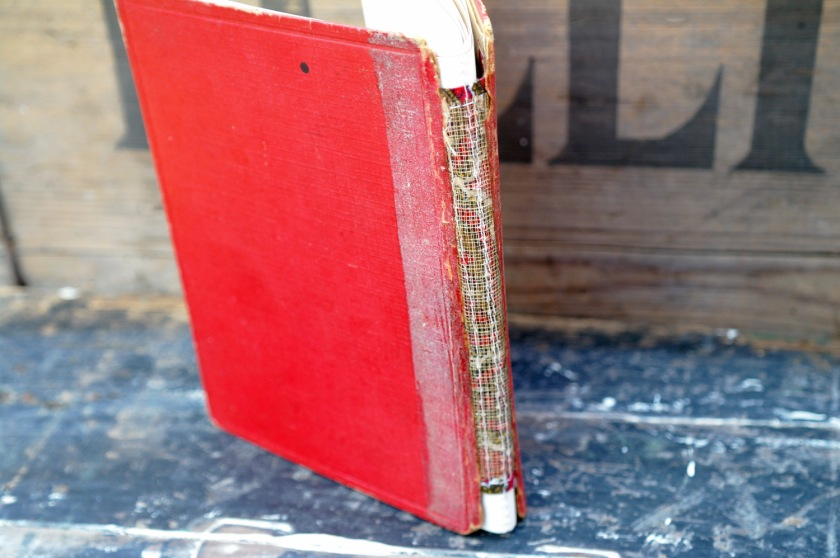 Spine of upcycled notebook, made from a vintage book cover.