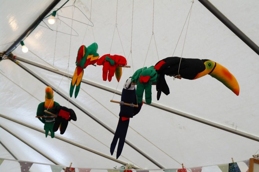 Toucans and parrots guarding the vintage tent.