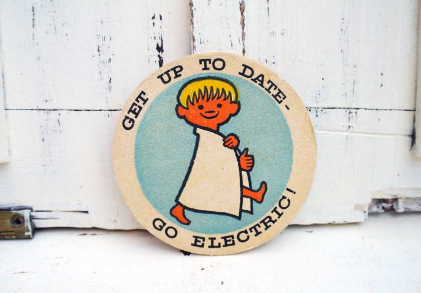 Get up to date - go electric. Vintage beer mat. Go electric vintage beer mat.