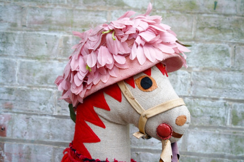 Silly pink vintage hat on handmade hobby horse.