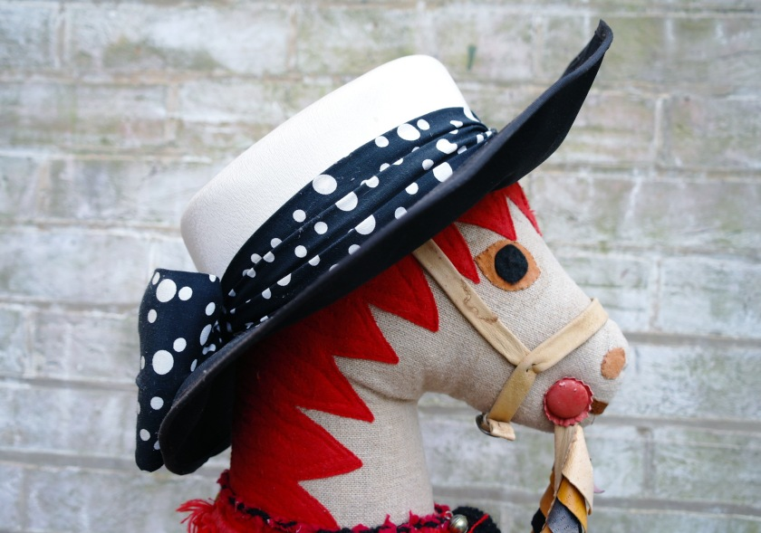 Hobby horse in a vintage hat.