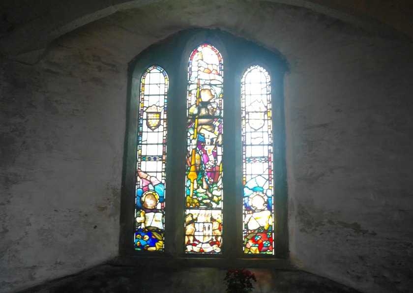 Stained glass window inside Tintagel church, Cornwall, UK.