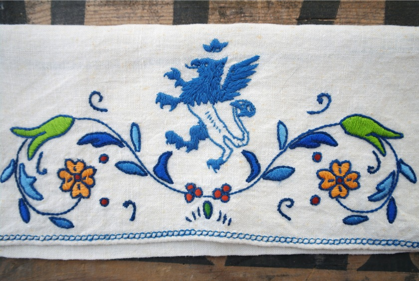 Vintage embroidered hankie holder. Handkerchief case. Embroider griffin mythical creature monster. Embroidered rampant lion with wings. Vintage embroidered linen.