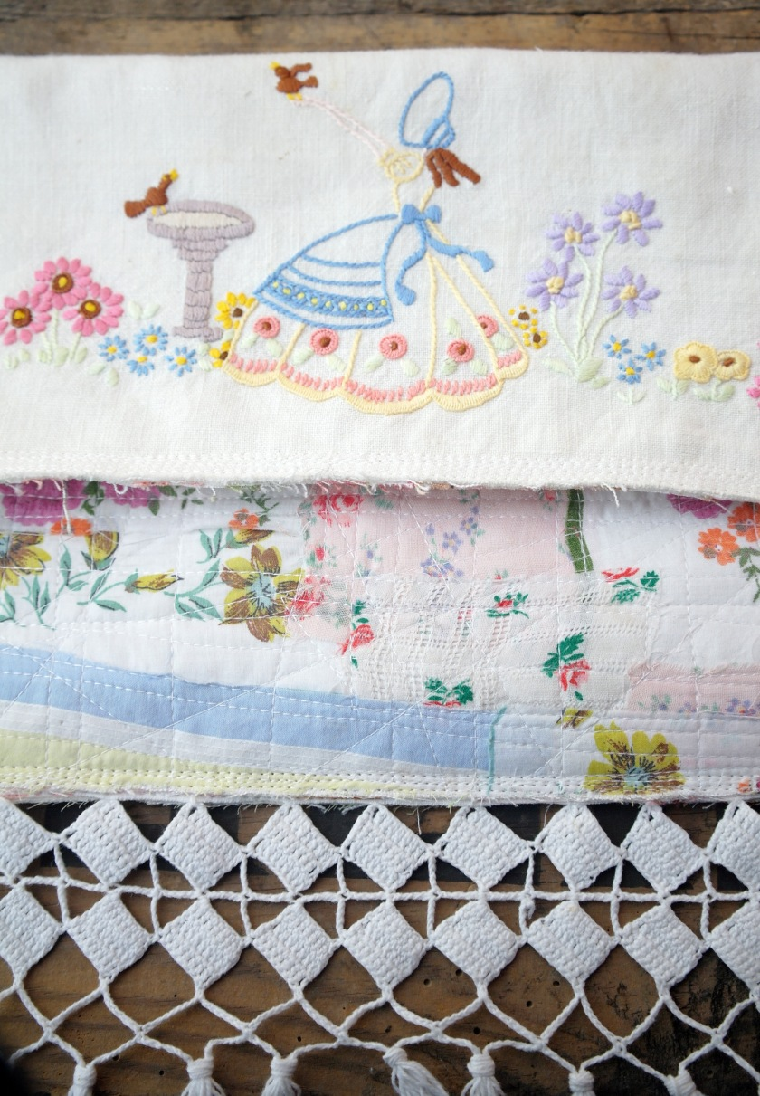 Vintage embroidery upcycled in to small handbag. Vintage embroidered crinoline lady. Quilted vintage hankies and fabrics, with vintage trim.