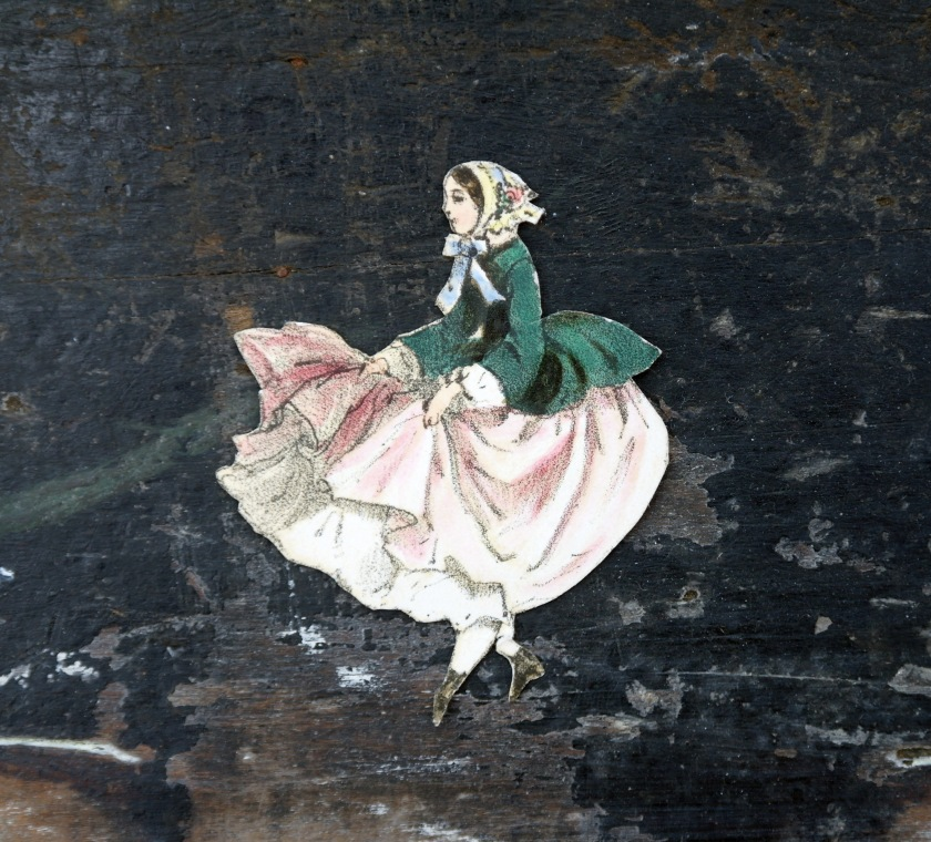Vintage die cut of a Victorian lady. Paper cut out. Whimsical, pretty, dainty, antique style.