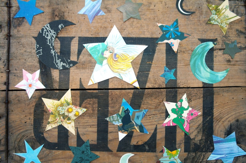 Stars and crescent moon shapes, cut out from vintage papers. Craft idea for Halloween. Decorations, garlands.